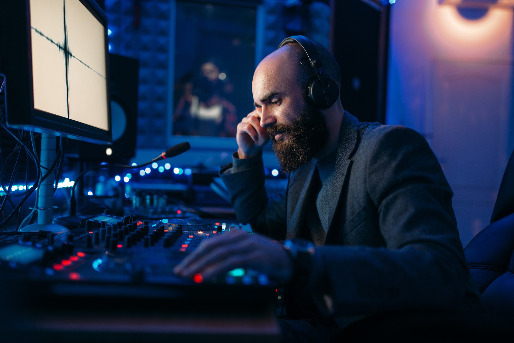 Sound engineer recording mixing desk